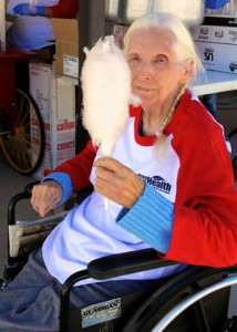 Rhonda Shears , a resident of E. Dene Moore Care Center, enjoys some cotton candy at the Vintage Base Ball game.